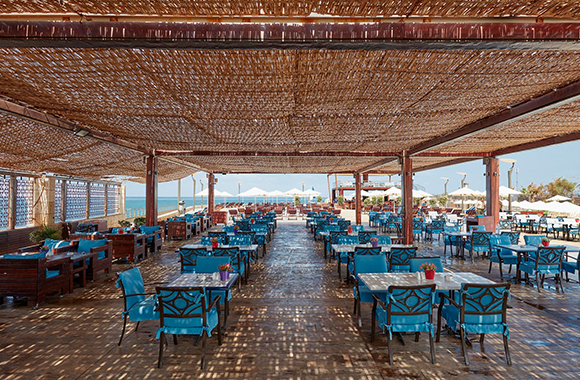 St Trop Tables Ready with Blue Chairs and Shades