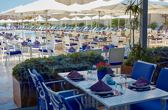 Sunsoul Restaurant - Tables Clean with Purple Napkins and Blue Chairs